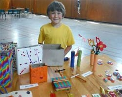 Caden at one of his craft tables during his annual fundraising craft sale.