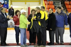 At the Miramichi Timberwolves Season Home Opener, Don Mac presents councillor Billy Flieger with a Mac's Seafood coat as a thank you for helping them out over the last year by getting them involved in the sports community. Photo by Greg MacDiarmid.