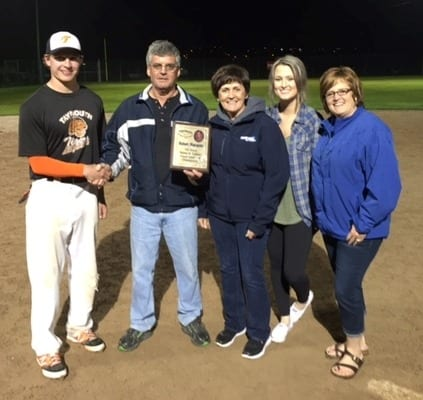 David Brewer, of the Taymouth Tigers, accepts the championship plaque from members of the Blacquier family - Raymond Blacquier, Roxanne Regan, Jenna MacKnight & Sherri Lynn MacKnight