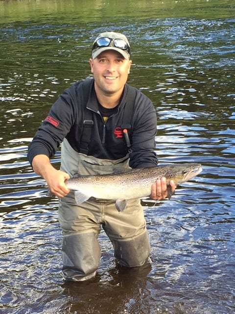 Joe Palmer with a hookbill salmon he caught on a blue bomber