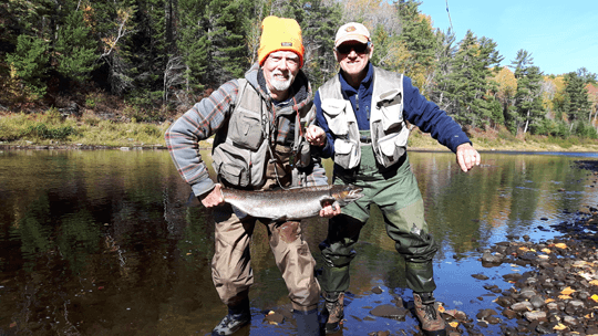Tom Bishop from Saint John with a nice henwith a little help from TK Tonge caught on the Wangatang Pool at Milletts on the Cains on the last day of the season.