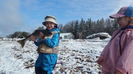 Young anglers with Jeff Morris catch and release a nice spring fish.