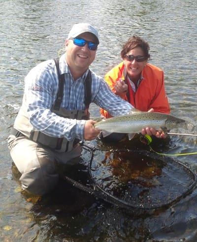 Head Guide Andrew Anthony with fish caught by Ledges guest Rose Arsenault