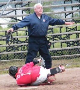 Umpire Pete McLean makes the call at home plate, as the Rangers score another on the way to a 12-8 victory.