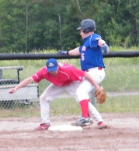 Another close play at third, this time with Sox' third baseman Jake Nicholson trying to make the tag on Rangers' pitcher Keith Sullivan.