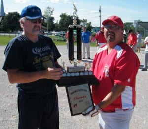 League Vice-President Mike McKenzie presents the championship trophy and plaque to Eel Ground Eagles player/coach Kelvin Simonson