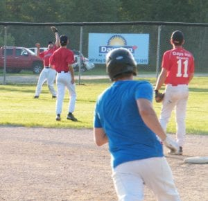 Miramichi Men's Fastpitch action: Stephen Boulay makes a grab in the outfield, dashing the hopes of the Douglasfield Dodgers.