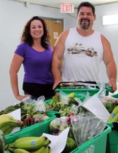 Brenda Hachey and her husband Les Ginnish packing Community Fresh Boxes.
