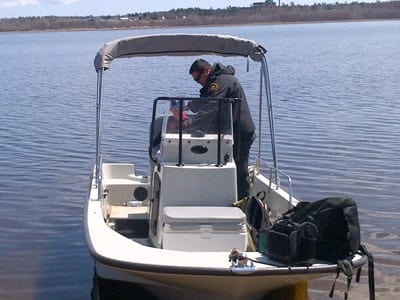 A new recruit for DFO during bass season is getting instructions on how to run the DF0 patrol boat by fishery officer Tyler Augustine