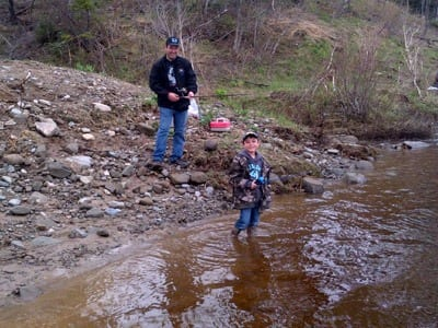 8 year old Payton Donalds of Derby fishing the SW Miramichi in hopes of cathcing a Bass