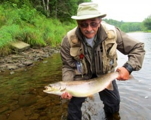 Peter Clark with a 22 pound salmon caught on a chartreuse bomber, number 4.