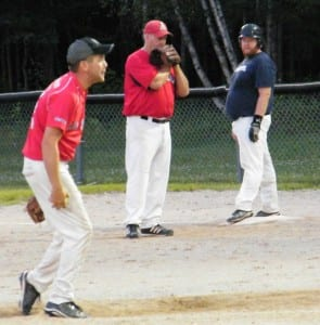 Sox Pitcher Jason Lynch, and first baseman Jimmy Keenan, look to the play, while Brewers base runner Blake Lynch weighs his options.