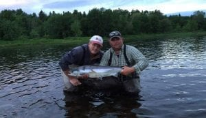 Stephen Leger with a nice June salmon, accompanied by guide Derek Munn.