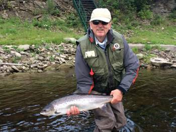 John McGuire with a nice fresh July salmon. Landed at one of Ledges pools on July 24th.