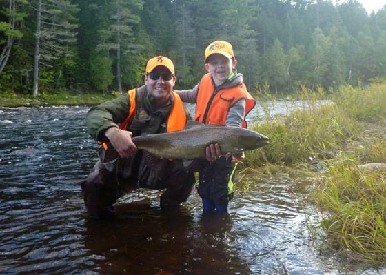 Jeff Morris and son Ben with a very nice salmon caught on the Main Southwest Miramichi