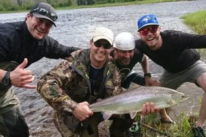 Jeff Morris with a nice bright salmon caught on the Northwest Miramichi